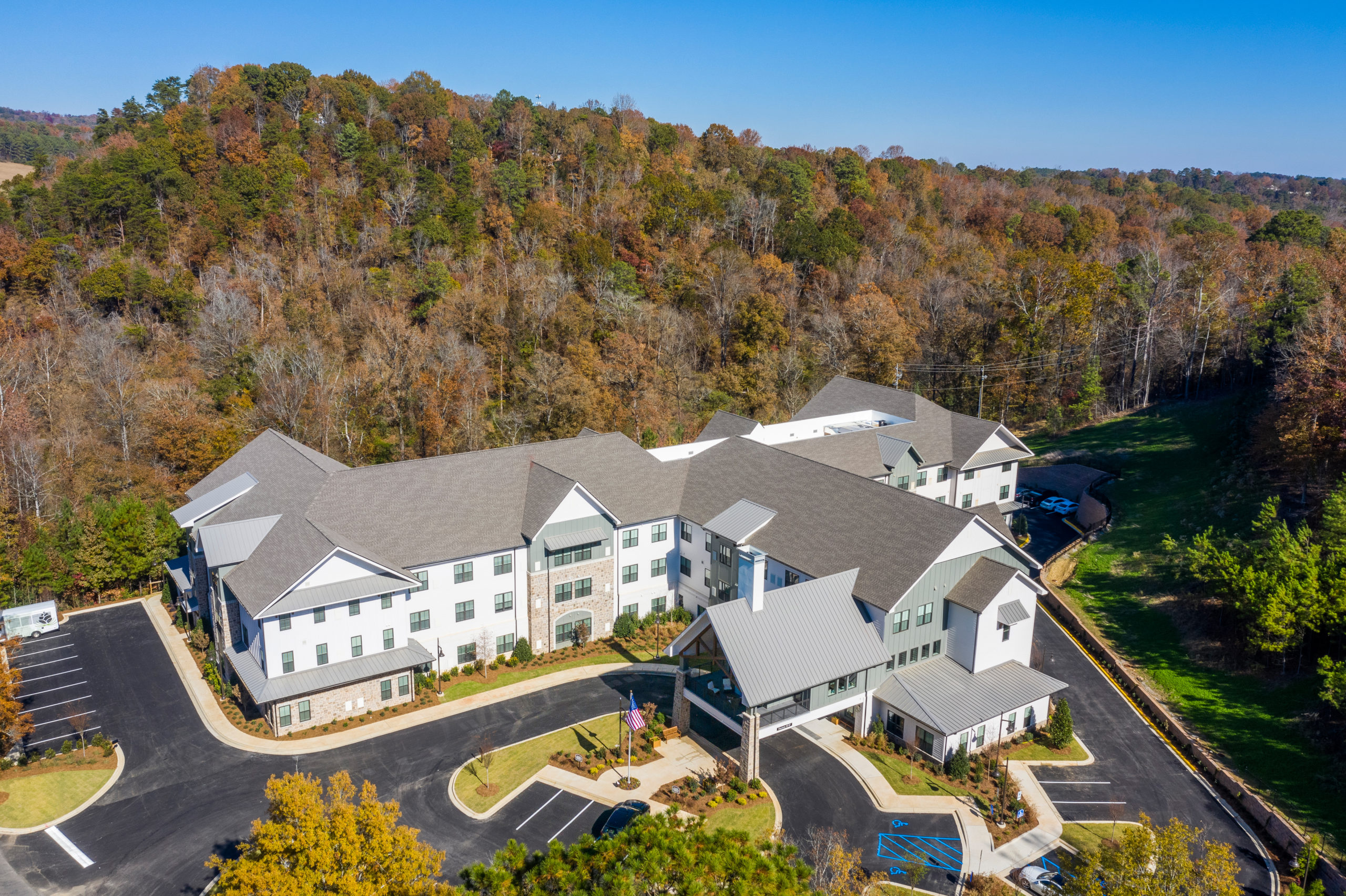 Aerial view of Longleaf community looking at front entrance with fall trees surrounding community