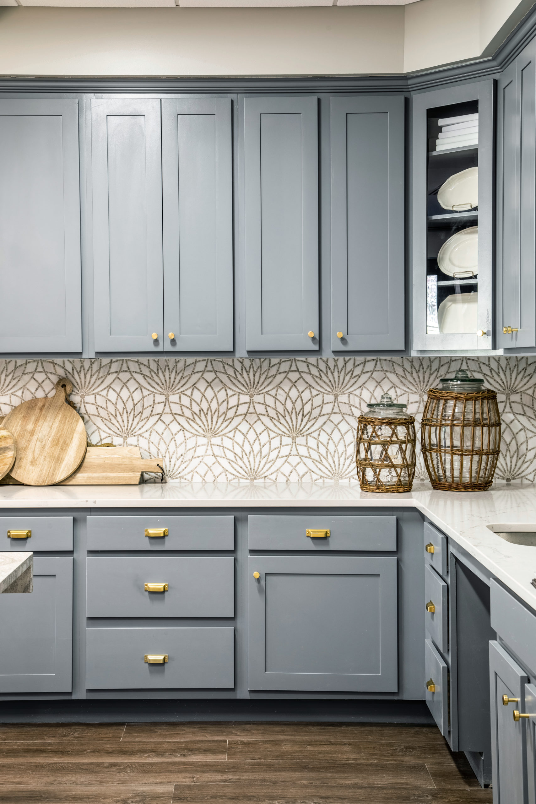 Blue cabinets and white counterops with basket and wooden decor in Longleaf common space